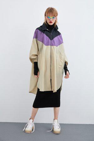 Zara Colour block raincoat with bag