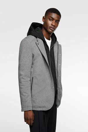 Zara Three-quarter-length coat with contrast hood