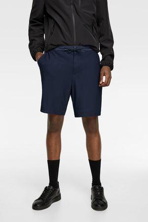 Zara Textured mesh bermuda shorts