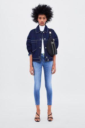 Zara Z1975 skinny jeans with neon button detail