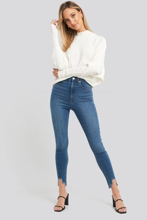 NA-KD Super High Waist Asymmetrical Hem Jeans - Blue