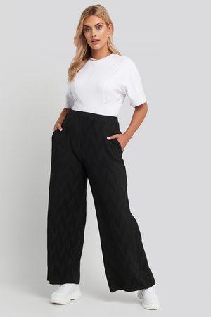 NA-KD Creased Effect Loose Fit Pants - Black