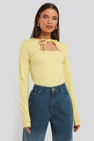 NA-KD Cut Out Long Sleeve Body - Yellow