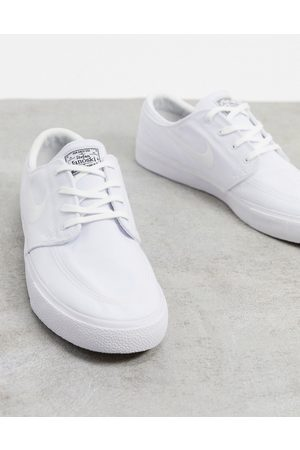 Nike Zoom Janoski Premium canvas trainers in triple white