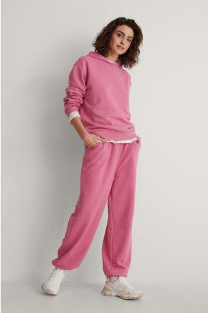 NA-KD Orgaaninen Collegehousut - Pink