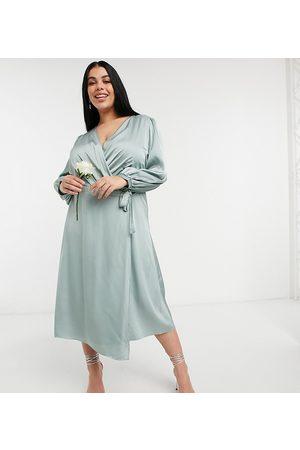 TFNC Plus Bridesmaid satin long sleeve wrap front midi dress in sage-Green