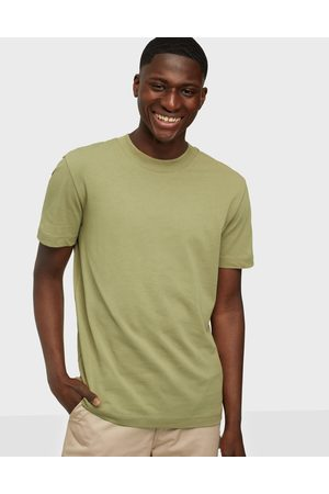 Selected Miehet T-paidat - SLHRELAXCOLMAN200 Ss O-Neck Tee S T-paidat ja topit Aloe