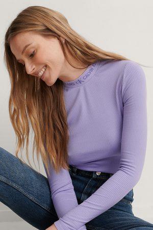 Calvin Klein Naiset Pitkähihaiset - Yläosa - Purple