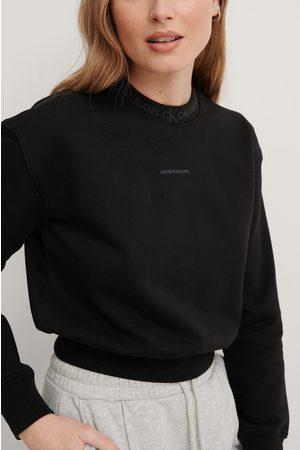 Calvin Klein Naiset Collegepaidat - Orgaaninen Collegepaita - Black
