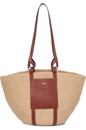Chloé Woody leather-trimmed raffia tote