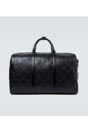Gucci Miehet Matkalaukut - GG embossed duffle bag