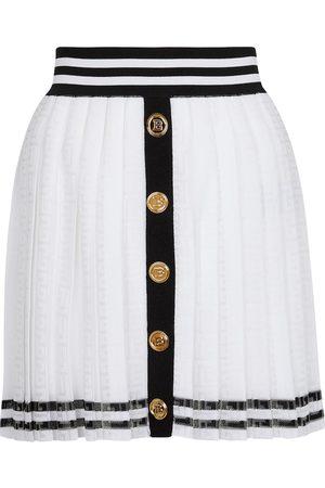 Balmain Naiset Minihameet - Pleated monogram knit miniskirt