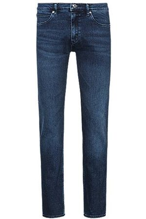 HUGO BOSS Mid-blue skinny-fit jeans in used-effect stretch denim