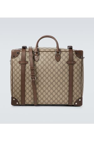 Gucci GG Supreme leather-trimmed suitcase