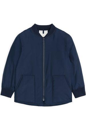 ARKET Tytöt Päällystakit - Padded Liner Jacket - Blue