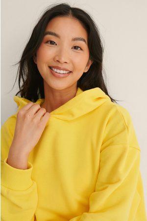 NA-KD Naiset Collegepaidat - Orgaaninen Oversized Taskuhuppari - Yellow