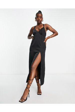 In The Style X Yasmin Chanel satin maxi dress with thigh split in black
