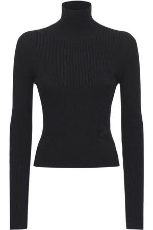 PATOU Wool Blend Rib Knit Turtleneck Sweater