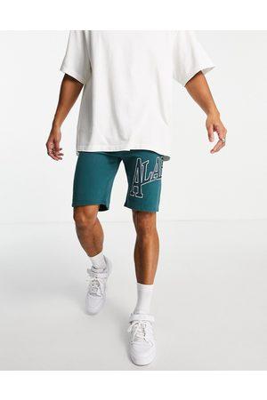 Topman Co-ord Alabama print shorts in green