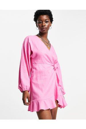 Topshop Volume sleeve wrap mini dress in bright pink