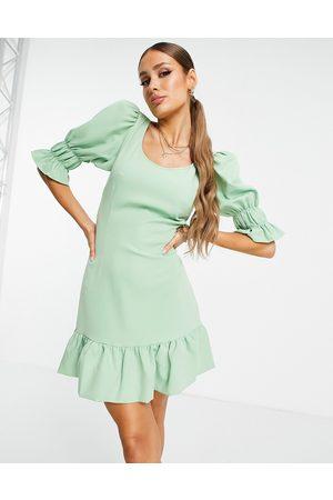 NA-KD Cut out side volume sleeve mini dress in dusty green