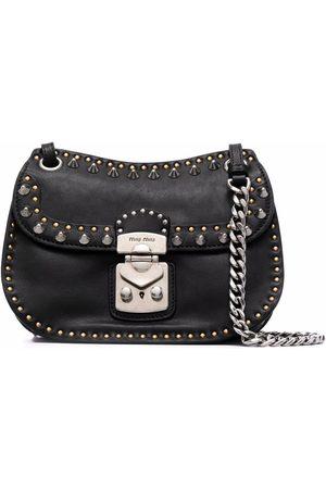 Miu Miu Naiset Olkalaukut - Studded leather crossbody bag